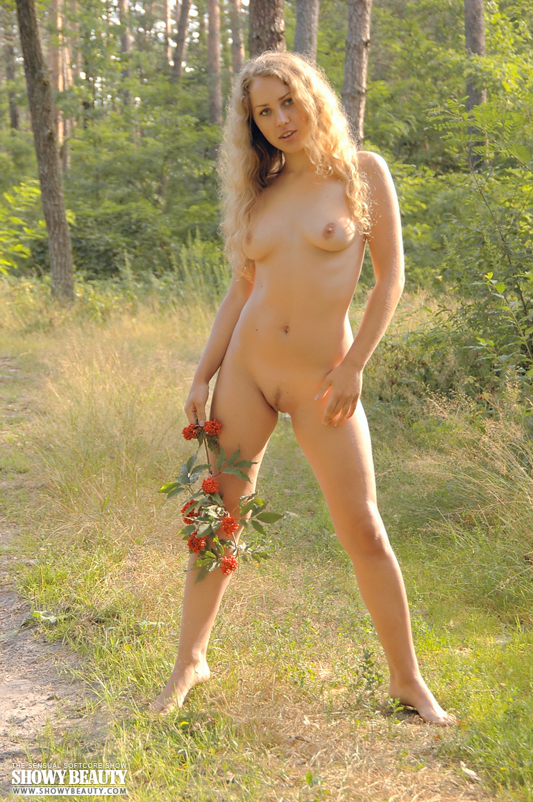 enchanting long haired fairy posing absolutely naked with