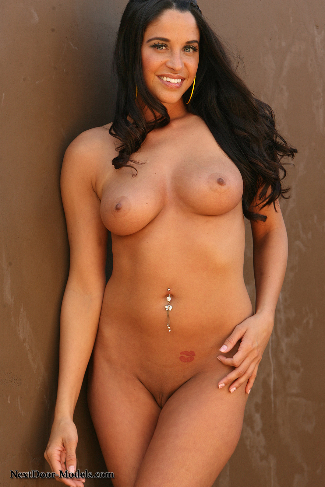 proudly showing off her belly button ring adrianna